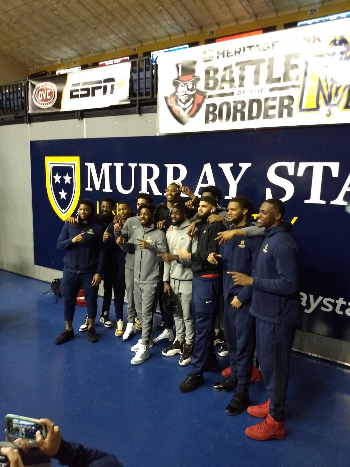The Racers take one last picture in the CFSB Center.