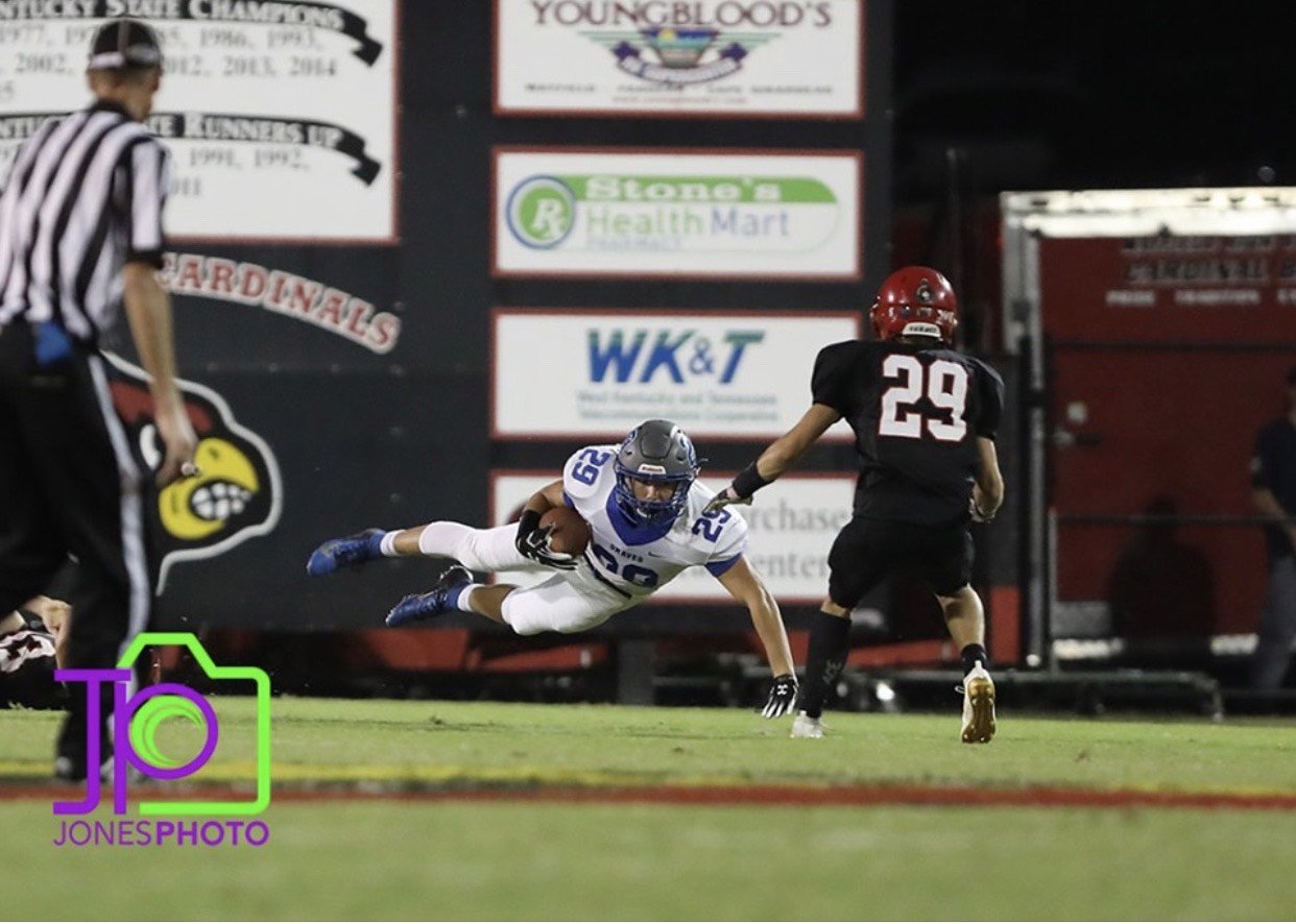 Clint McKee with an iron grip touchdown. Photo courtesy of Jones Photography.