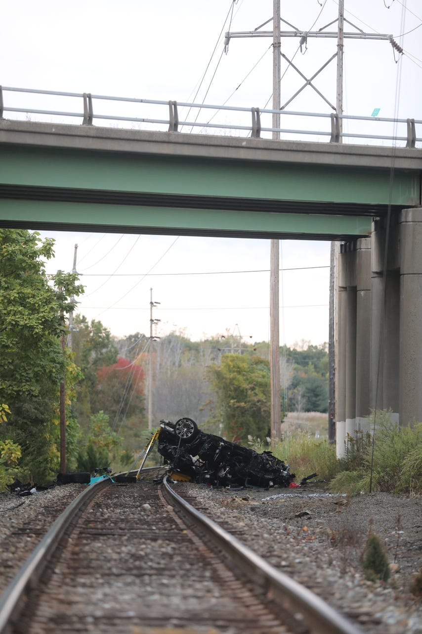 Porsche went off overpass onto train tracks near West Crooked Hill Road. (Photo courtesy of USA Today News)