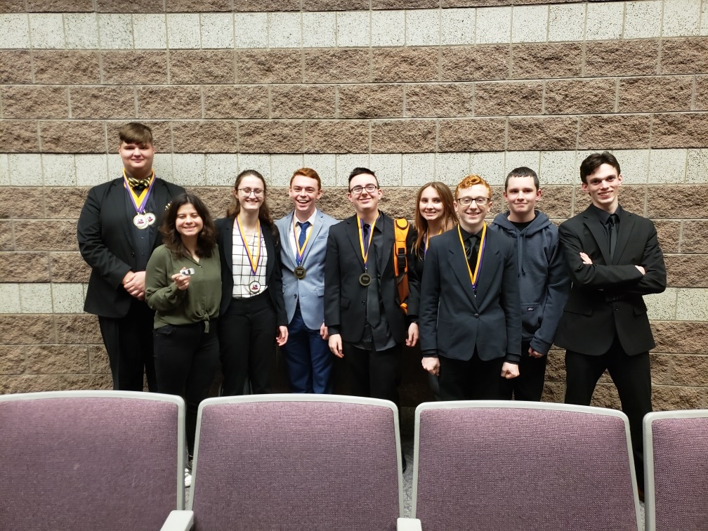 (from left) Michael Black, 3rd place, Impromptu Speaking, 5th place, Original Oratory, 5th place, Poetry; Mina Cakilkaya, 7th place, Humorous Interpretation; Olivia Gregory, 6th place, Storytelling; Kendall Tubbs, 6th place, Extemporaneous Speaking; Aidan Walker, 2nd place, Storytelling; Carrie Cavitt, 4th place, Storytelling; Nick Lashbrook, 7th place, Extemporaneous Speaking, 4th place, Humorous Interpretation; Landon Ray; John Roberts.