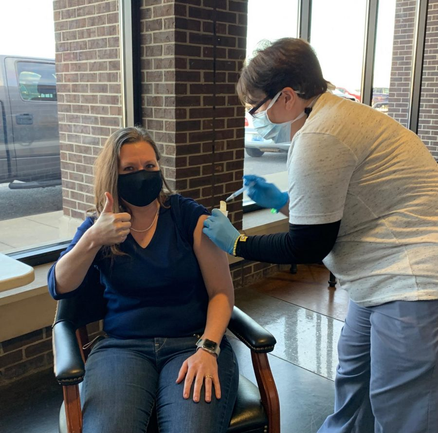 8th grade teacher Adrienne Custer receives the first dose of the Moderna Covid-19 Vaccine.