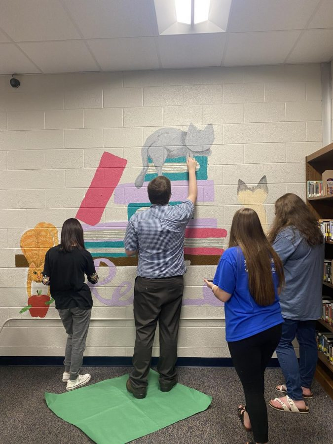 Student murals line the walls of the GCHS Library
